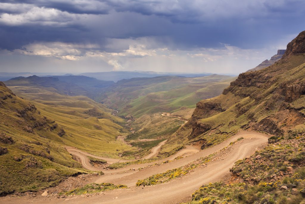 Endless hairpin turns on the dirt road leading towards the Sani Pass on the border of South Africa and Lesotho.